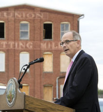 Mayor in front of Union Mills.jpg